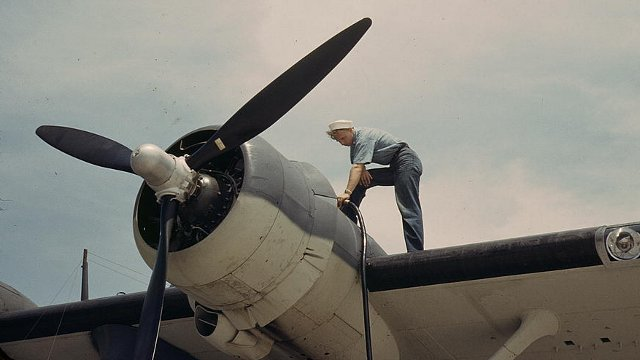 Sailor mechanic fueling a plane